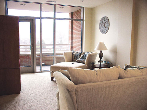 Condo interior with couch in Waterfront Place Hotel